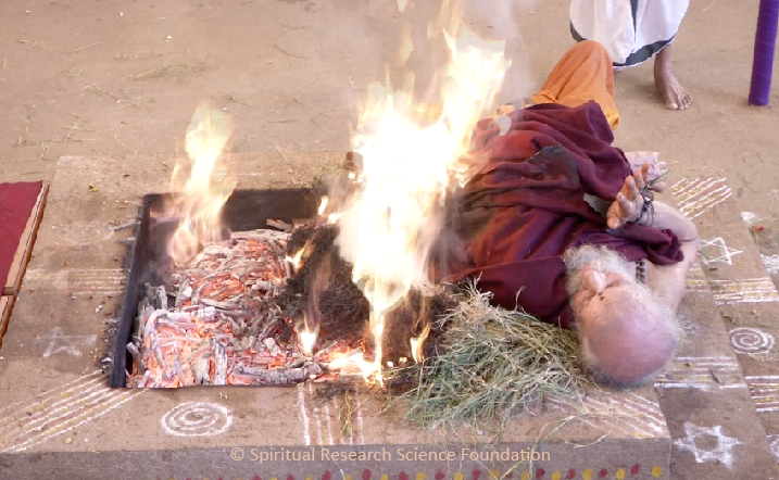 Fire Yogi at the Spiritual Research Centre enveloped with flames