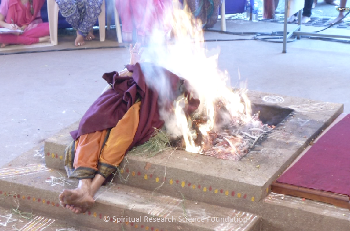 Fire Yogi at the Spiritual Research Centre covered with flames