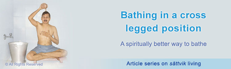Spiritual effect of bathing in a cross legged position