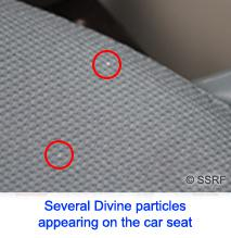 several divine particles appearing on car seat
