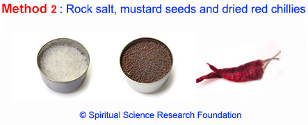 Rock salt, mustard seeds and dried red chillies for evil eye removal