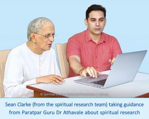 Sean Clarke (from the spiritual research team) taking guidance from Paratpar Guru Dr Athavale about spiritual research