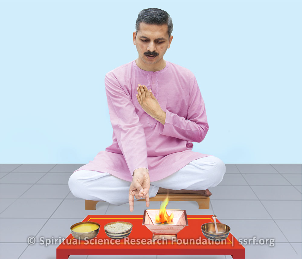Performing the Agnihotra ritual