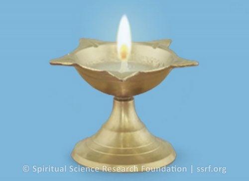1. Lighting a ghee lamp or a sesame seed oil lamp