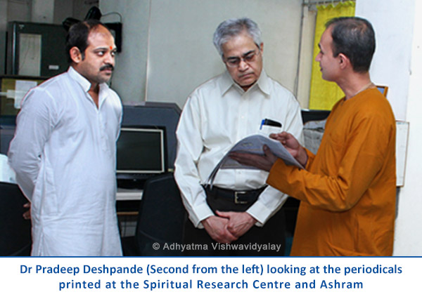 Dr Pradeep Deshpande looking at periodicals