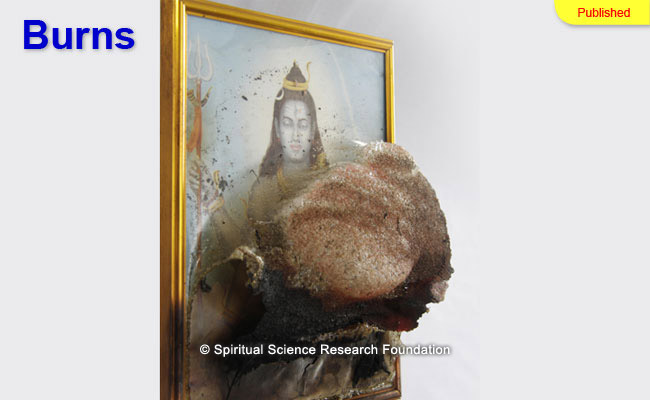 Spontaneous acid like burns through a picture of Lord Shiva causing it to erupt by 2-3 cm from its surface