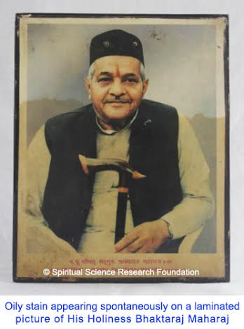 oily stain on H H Bhaktraj Maharaj picture