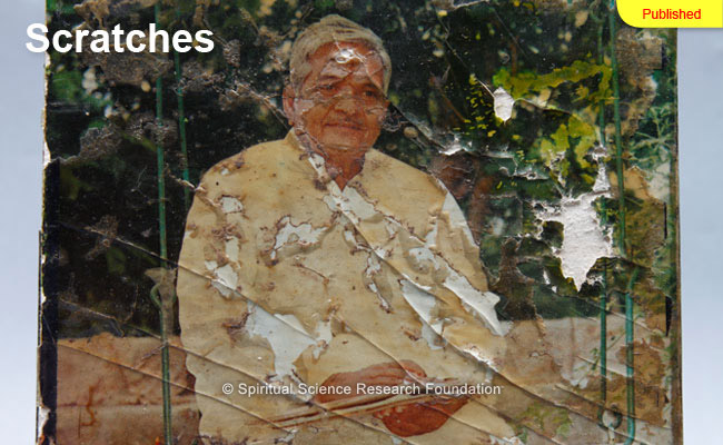 Severe scratches appearing on a picture of His Holiness Bhaktaraj Maharaj